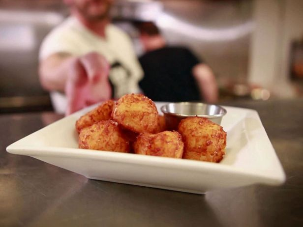 Tavern Tots — Highland Tavern (Denver) : Chef Jeremy McMinn says he gave up on traditional methods of making this bar staple and ended up creating his own process. They boil the potatoes, shred them, liberally mix in the seasonings, then shape them and deep-fry them — no dehydrating needed.