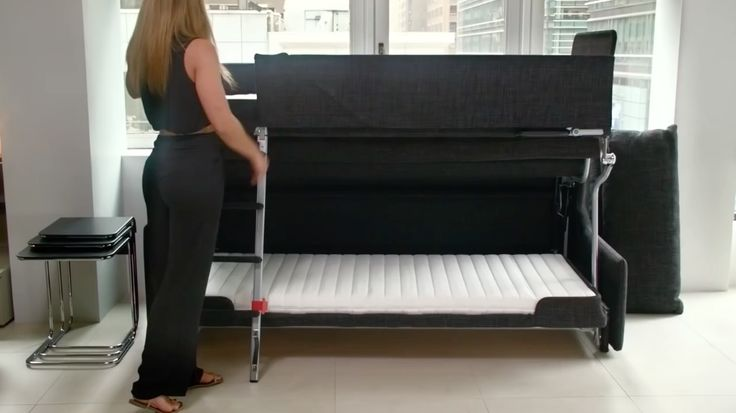 Woman turns sofa into bunk bed, other space saving furniture