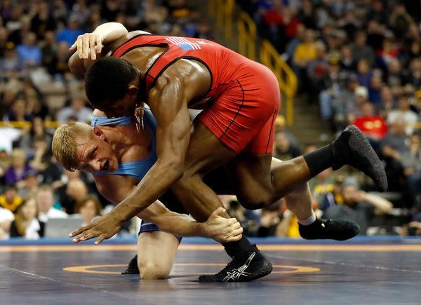 Kyle Dake and J'Den Cox compete in the 86kg freestyle championship match during day 2 of the 2016 U.S. Olympic Team Wrestling Trials at Carver-Hawkeye Arena on April 10, 2016 in Iowa City, Iowa.