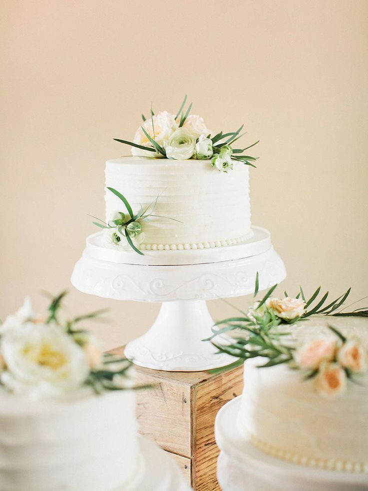 If you can't settle on one single wedding cake flavor or style, consider  a spread of multiple single tier cakes with different flavors and designs.