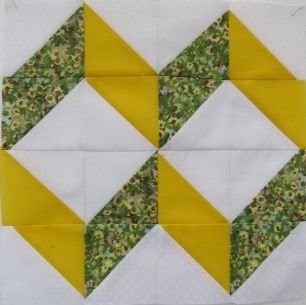 The Ribbons quilt block is an easy four patch block made entirely from half square triangles. Shown with two quilt suggestions.