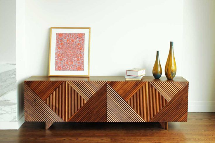 Enzo side board from http://criteriacollection.com.au  A variation on the classic sideboard storage unit. Made of american walnut, danish oil finish