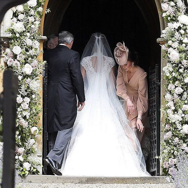 Here comes the Bride ! The wedding of Pippa Middleton with James Matthews. Pippa Middleton stunned in a slinky white gown by British couturier Giles Deacon.