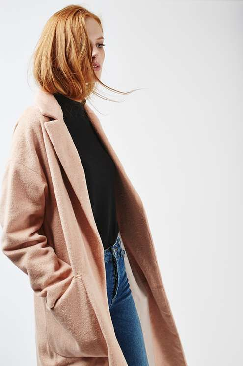 Longline slouch coat in pink, with patch pockets to front and silver popper…