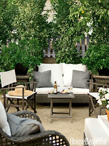Handsome gray and white Sunbrella fabrics cover most of the furniture.