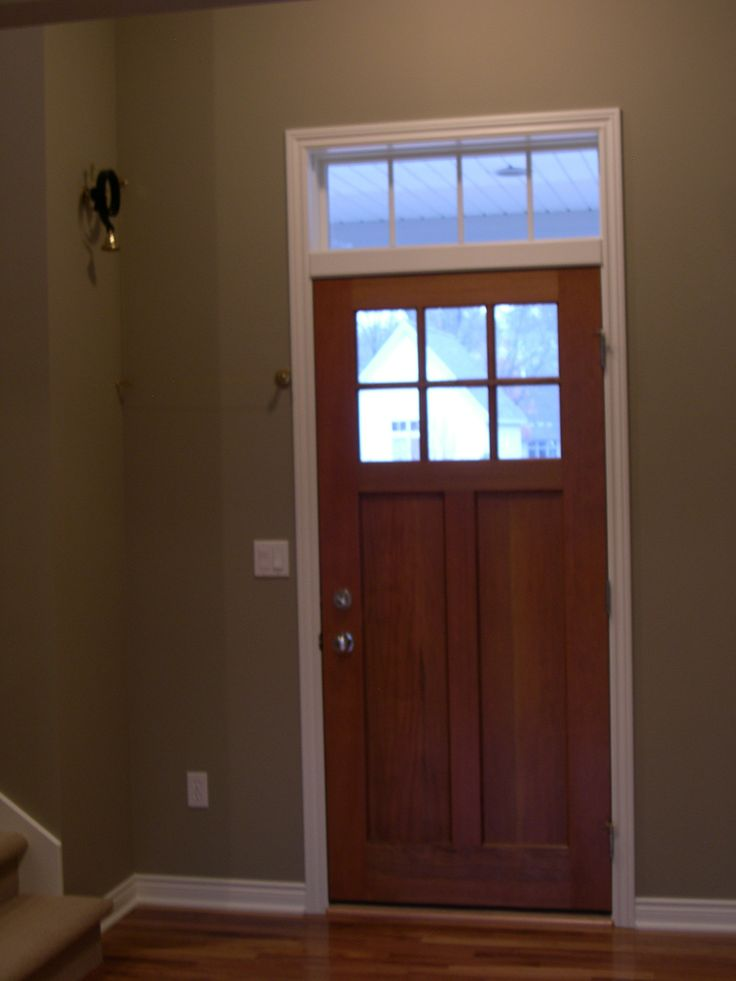 Front entry, stained Craftsmen style door with unique door bell.