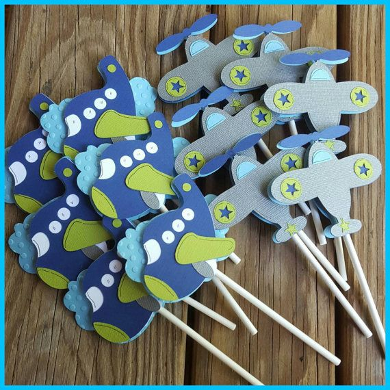 Set of 6 airplane cupcake toppers. Each is about 3 inches and fully covered on the back so the lollipop stick does not show. They are one sided. You can get all one plane or both. I can also make a cloud with age..just let me know! Easy!! Also..if you want these in a different color scheme...just let me know!