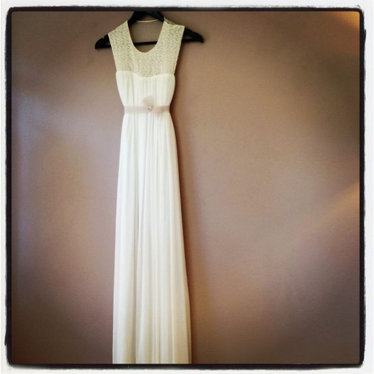 Elegant and understated, this dress is made unique by the vintage bib used.