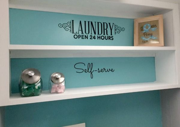 Ideas for laundry room decor, including vinyl wall decals and laundry detergent storage containers, shown by a reader, Julie {featured on Home Storage Solutions 101}