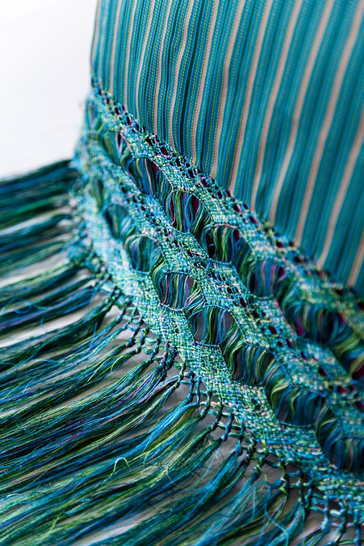 Hand woven ikat luxury silk floss rebozo pillows with fringe (detail) - We love the color, patterns, variety and workmanship that go into the beautiful hand made textiles of Mexico - to see more visit www.mainlymexican.com #Mexico #Mexican #textile #rebozo #woven