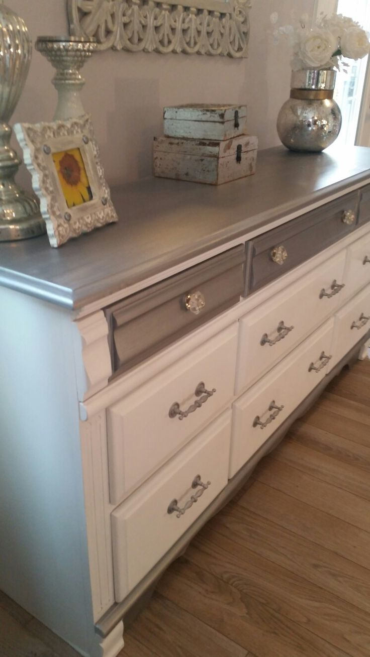 Repurposed old oak dresser. Done in white and metallic silver and new knobs to finish it off.  https://m.facebook.com/ChicandShabbyFurnitureByRebecca/