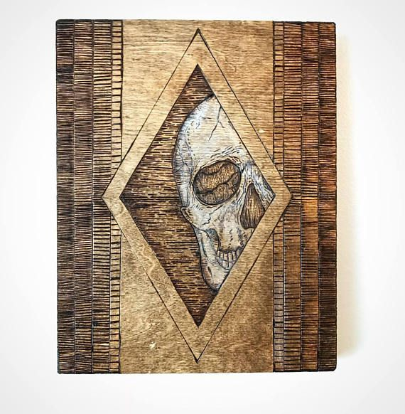 Geometric skull wood burning Skulls and lines