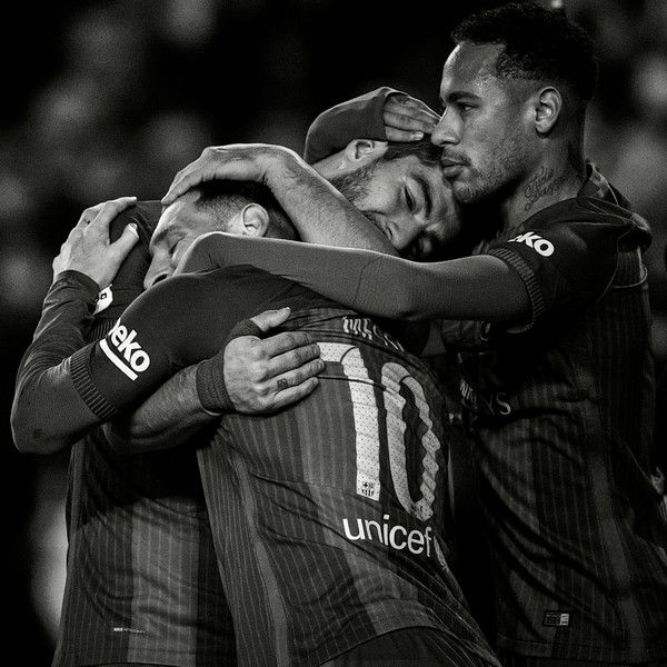 This image has been converted to black and white) Luis Suarez (C) of FC Barcelona celebrates with his team mates Lionel Messi (L) and Neymar Jr. after scoring his team's second goal during the La Liga match between FC Barcelona and RCD Espanyol at the Camp Nou stadium on December 18, 2016 in Barcelona, Catalonia.