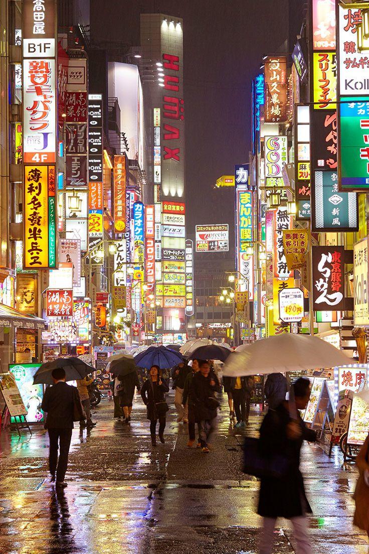 The neon-lit streets of eastern Shinjuku in Tokyo. Every day, three million people pass through its station - the busiest in the world // photo by Matt Munro #tokyo #shinjuku #japan #rain