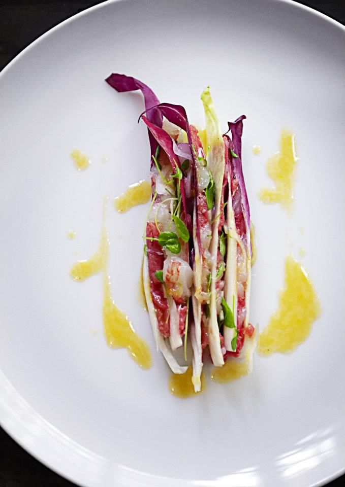 Upside down tatare of bison oxe, bitter salads and sweet prawns. By Nordic Star Chef Mads Refslund. See more of his dishes at http://bon-vivant.dk/mads-refslund