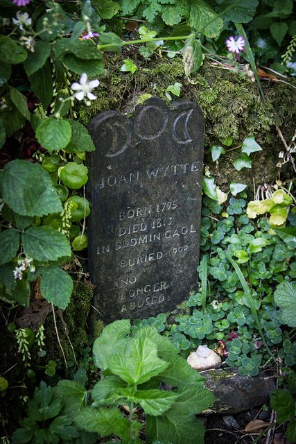 "The grave of Joan Wytte, white witch.  Stone reads: Born 1775. Died 1813 in Bodmin Jail. Buried 1998. No longer abused""."