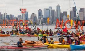ShellNo flotilla participants hold signs during demonstrations against Royal Dutch Shell