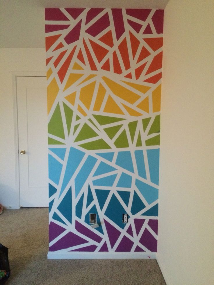 Fun and easy way to get some color on an accent wall. Frog tape and paint samples.