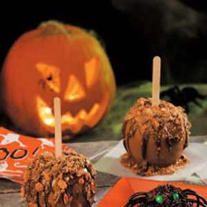 Halloween Caramel Apples    For added creativity melt white chocolate and draw faces on your apples! Kids love it!