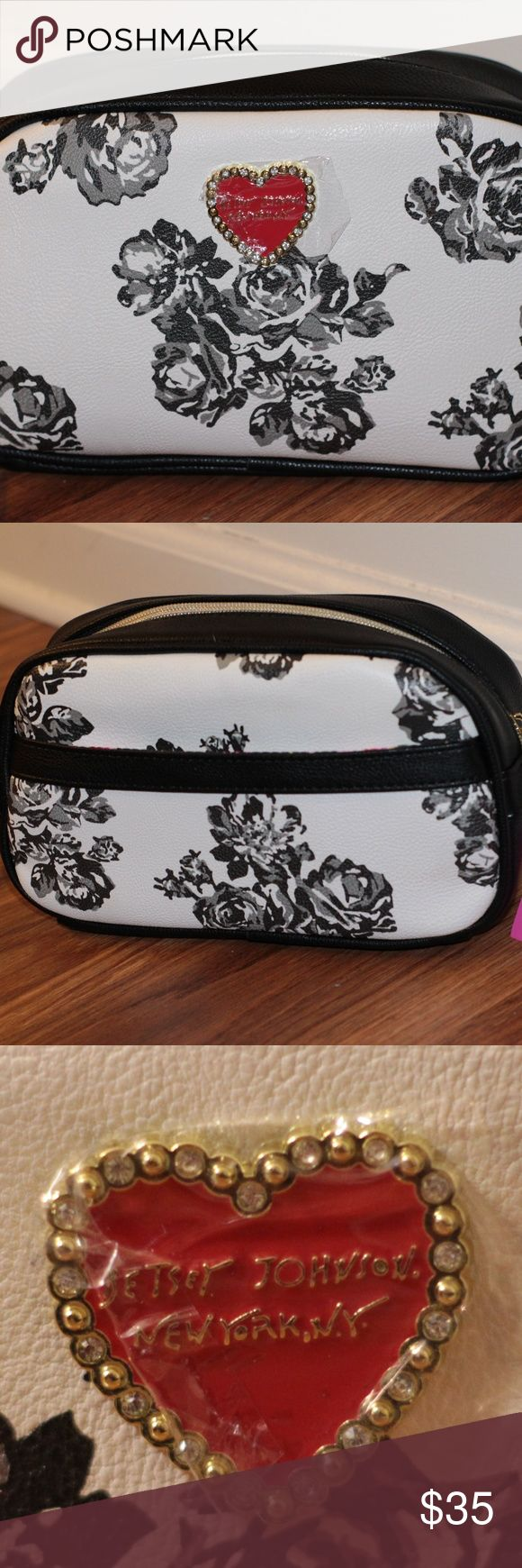 Betsey Johnson Small Cosmetic Bag Super cute Betsey Johnson cosmetic bag with a black rose pattern on a white background. Brand new, never used. Betsey Johnson Bags Cosmetic Bags & Cases