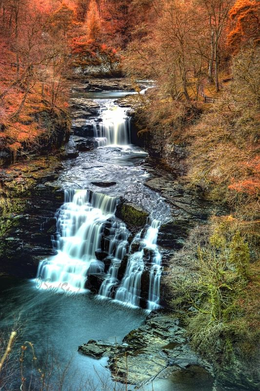 The spectacular Corra Linn waterfall at the Falls of Clyde, New Lanark, Scotland.