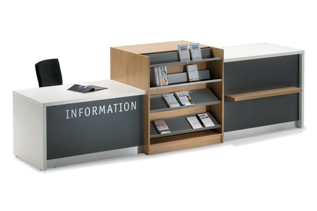 Inform Counter System - BCI - display space: I think the best place for the circulation desk is the middle of the library, just in front of the nonfiction wall. We could remove the cabinets on one side of the wall and convert all of that to bookshelves. Then, we could move the storage and work counter to behind the circulation desk.