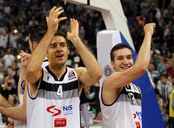 Milenko Tepić and Bogdan Bogdanović celebrating after the match (KK Partizan - CSSZKA Moscow 73-72 17.01.2014)