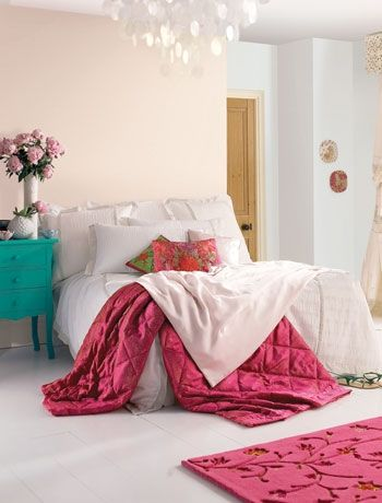 Pretty in pink  bedroom colour scheme. Create a gentle scheme with a pale pastel background and inject it with touches of deeper colour like this room for a stronger impact. Using a deep magenta pink and touches of turquoise blue adds a colour lift to this room. Paint by Dulux.