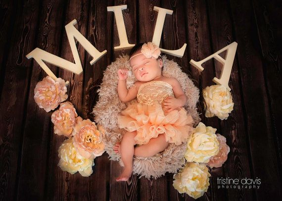 Peach Lace Newborn Dresses Photography Props by TheDamaskBaby. I also like the letters of the name surrounding the baby.