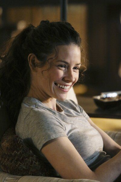 "Evangeline Lilly, taking a break. She wore the gray T-shirt through much of Seasons 5 AND 6, but I don't remember ANY on-Island scene where she was relaxed and smiling like this! Based on the furniture and her hair up in a ponytail, it looks like this picture was taken during 5.11 ""Whatever Happened, Happened""."