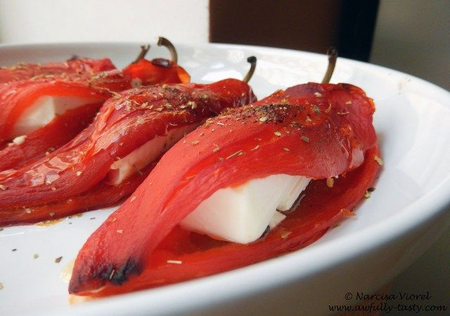 Roasted stuffed peppers with feta cheese and drizzled with olive oil and dried oregano.   Ardei copti cu feta si stropiti cu ulei de masline si oregano.   http://awfully-tasty.com/2014/08/18/ardei-kapia-copti-cu-feta/