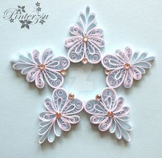Quilled snoflake by pinterzsu