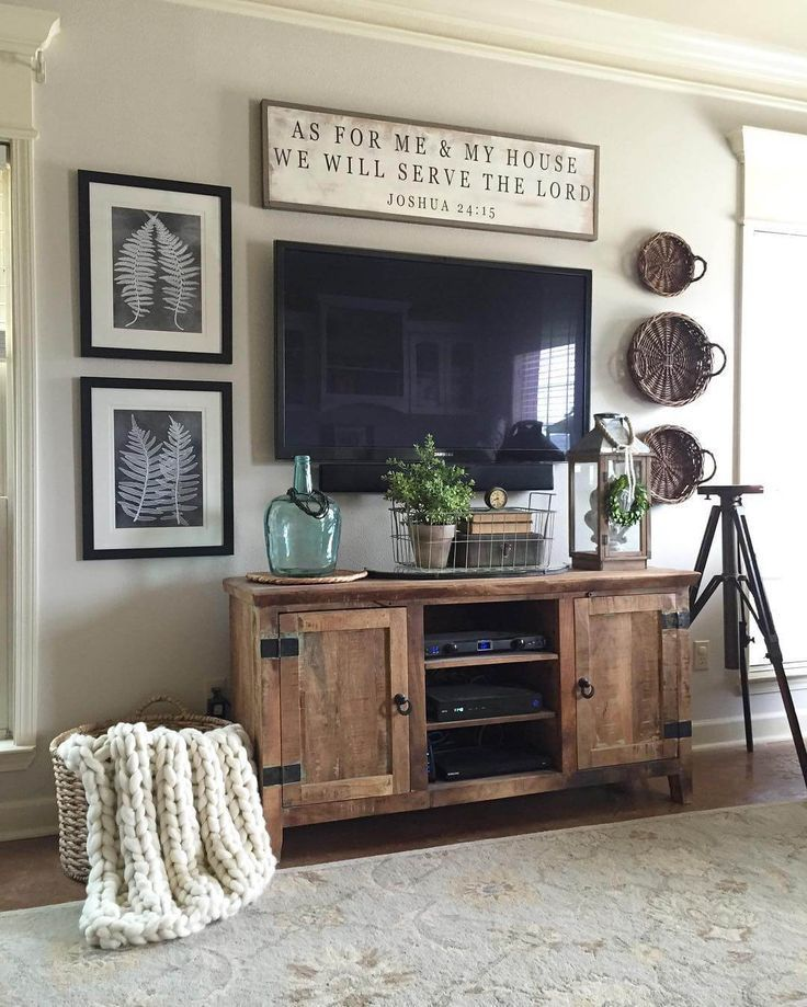 A perfect modern farmhouse setup: a rustic cabinet, baskets, and a rustic sign.