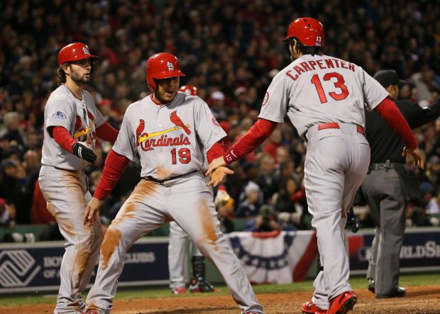 Jon Jay and Pete Kozma score in the seventh inning of Game 2 of the 2013 World Series. Cards defeat Red Sox 4-2, 10/24/13.