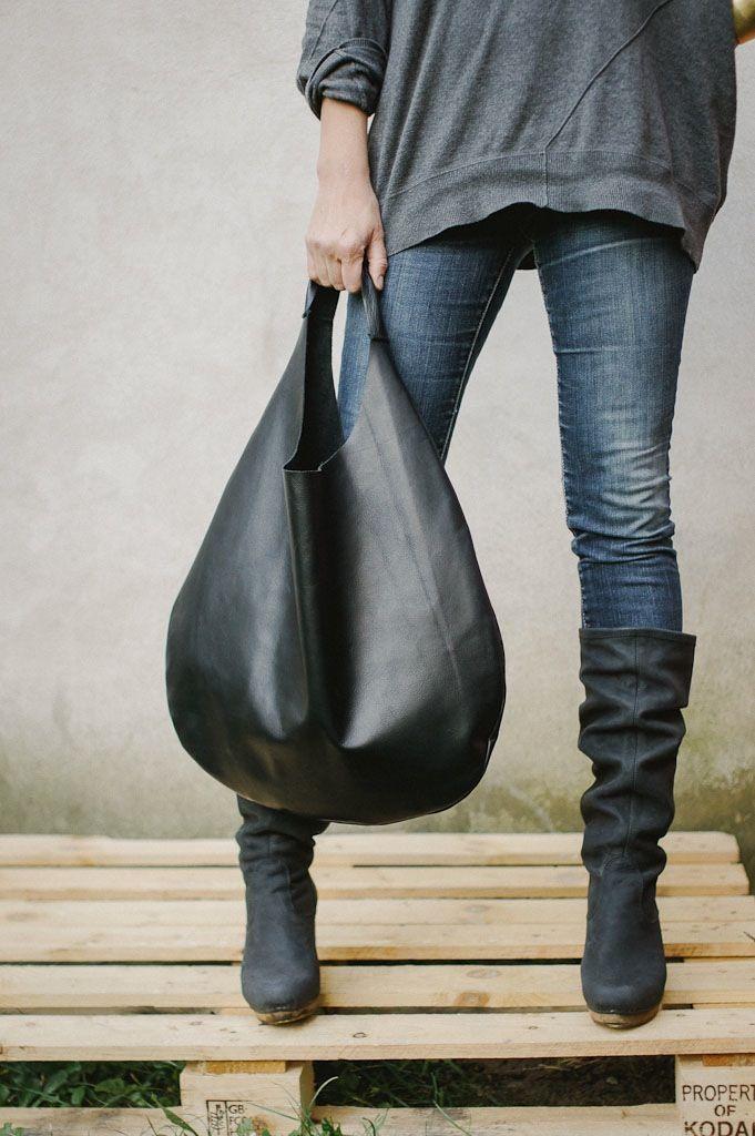 Black simple leather shoulder hobo bag. Soft italian leather. No lining,no internal pockets. Simple all day large bag . -soft italian leather...