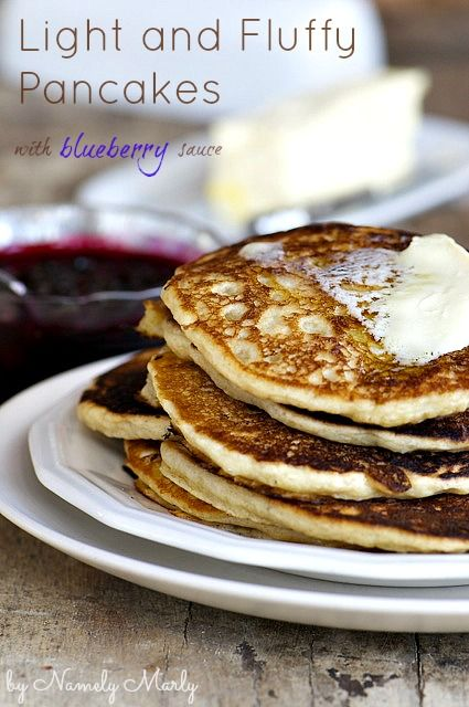 A delicious stack of pancakes with blueberry sauce