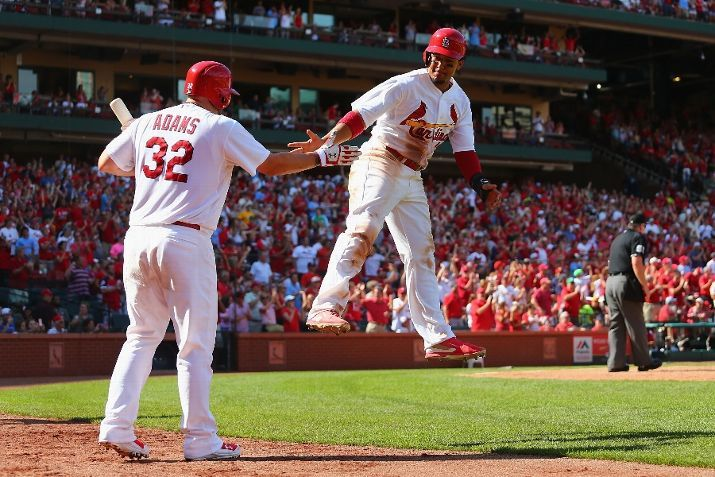 Jon Jay celebrates with teammate Matt Adams after scoring what would be the game-winning run in the seventh inning against the Pittsburgh Pirates.  9-01-14