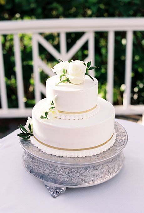 Brides: Classic White Cake with Pearl Details & Flowers. A two-tiered white wedding cake with piping and fresh flowers.