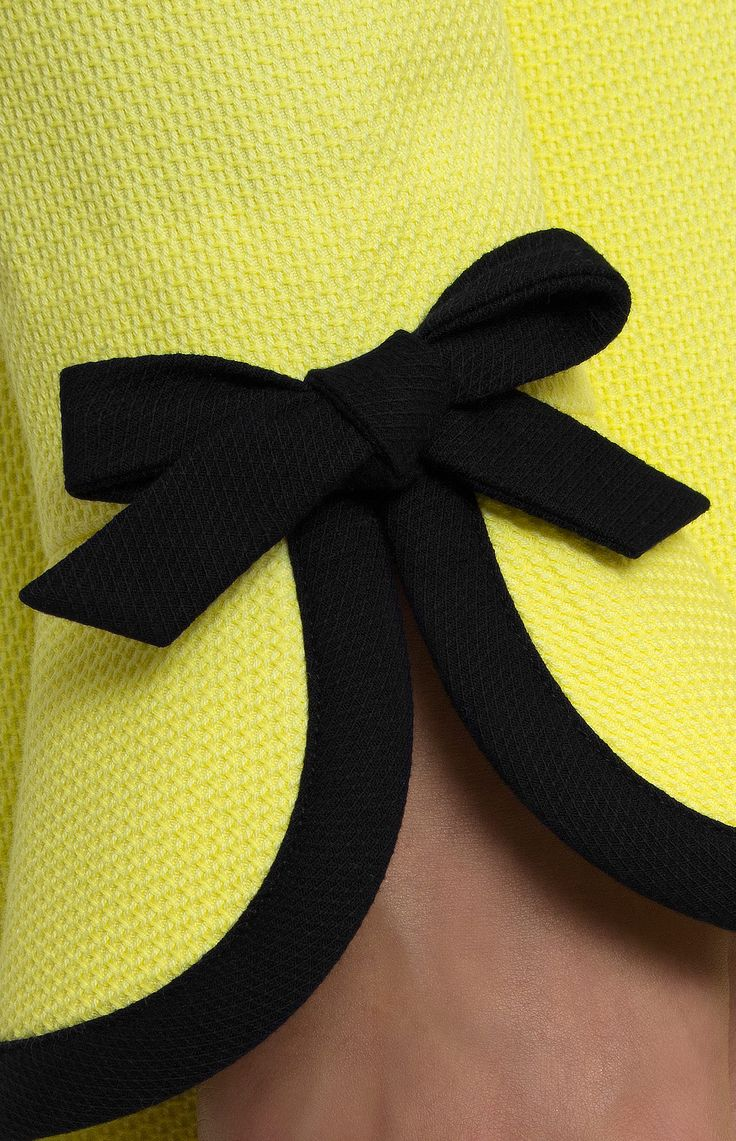 Yellow textured cotton dress with black trim. Upper and lower flounce collar on a stand. Hidden back zip closure. Long sleeves with bows. Without pockets. #Pintel #work #yellow #black #party #cotton #dress #cute #pretty #midi #style