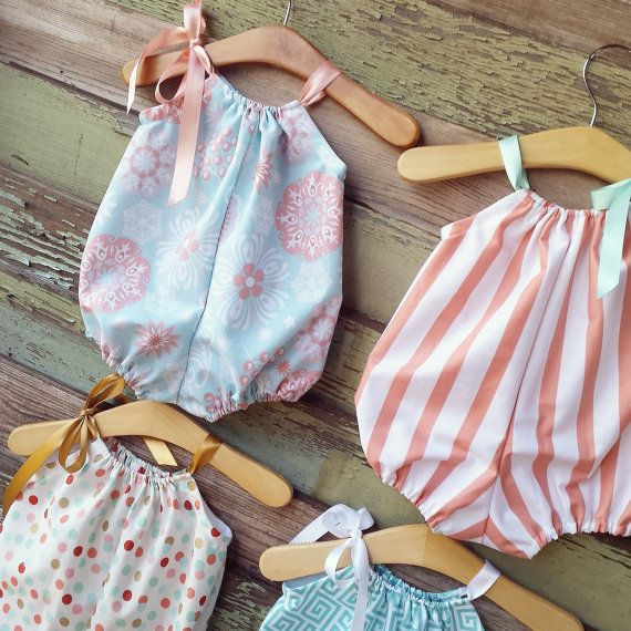 This simple bubble romper is available in your choice of fabric. Choose from a coral stripe, turquoise greek keys, polka dot, or blue floral.