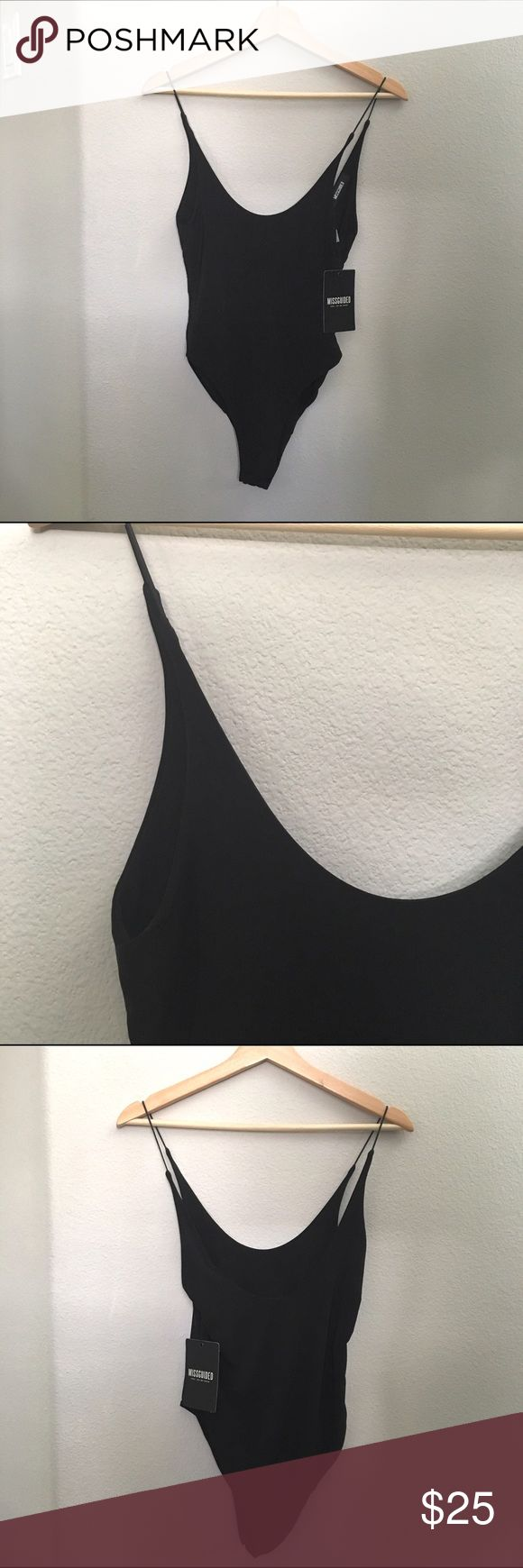 NWT Black slinky low back high leg bodysuit Brand: Missguided. New with tags. Size US 6/UK 10. Has button clasps at the bottom. Super soft and slinky. Delicate straps. NO SWAPS. #black #nwt #new #slinky #bodysuit #delicate #straps #missguided   Fun fact: I discount bundles! :) Missguided Tops Tank Tops