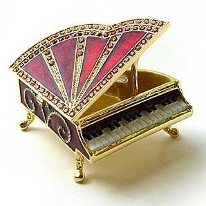Red Grand Piano Box Swarovski Crystals 24K Gold Jewelry, Trinket or Pill Box FREE SHIP! Certificate of Authenticity by PSDZ. $39.95. Arrives in a padded, satin lined Presentation Box. 100% Satisfaction Guaranteed by this bonded seller.. Detailed in 24 karat gold and set with sparkling Swarovski Crystals and meticulously hand enameled by skilled artisans.. This exquisite Piano Box opens to reveal a compartment that's been completely finished in a swirled, irides...