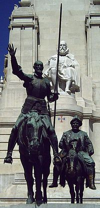 """Bronze statues of Don Quixote and Sancho Panza, at the Plaza de España in Madrid"" -- with Cervantes in the background."