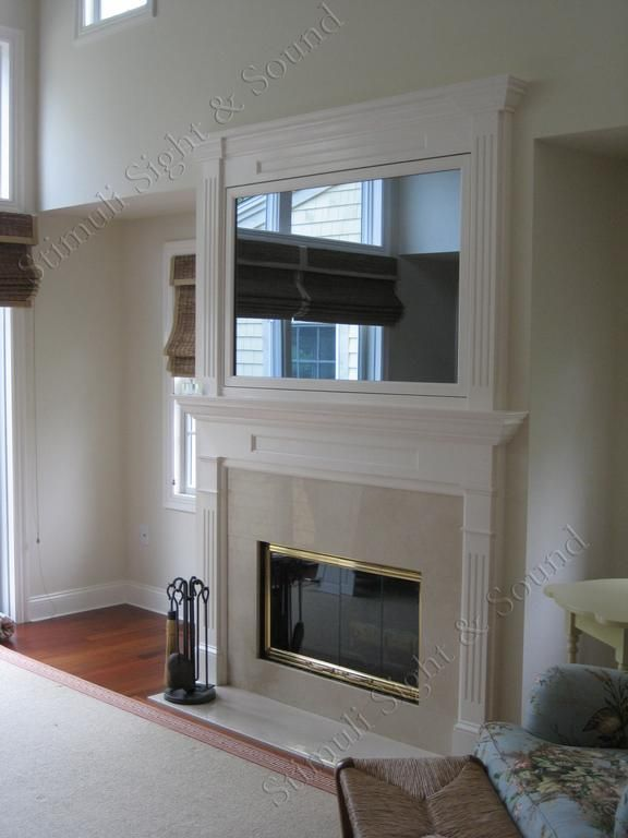 Hidden TV Over Fireplace | Seura television mirror over fireplace from Stimuli Sight & Sound LLC ...