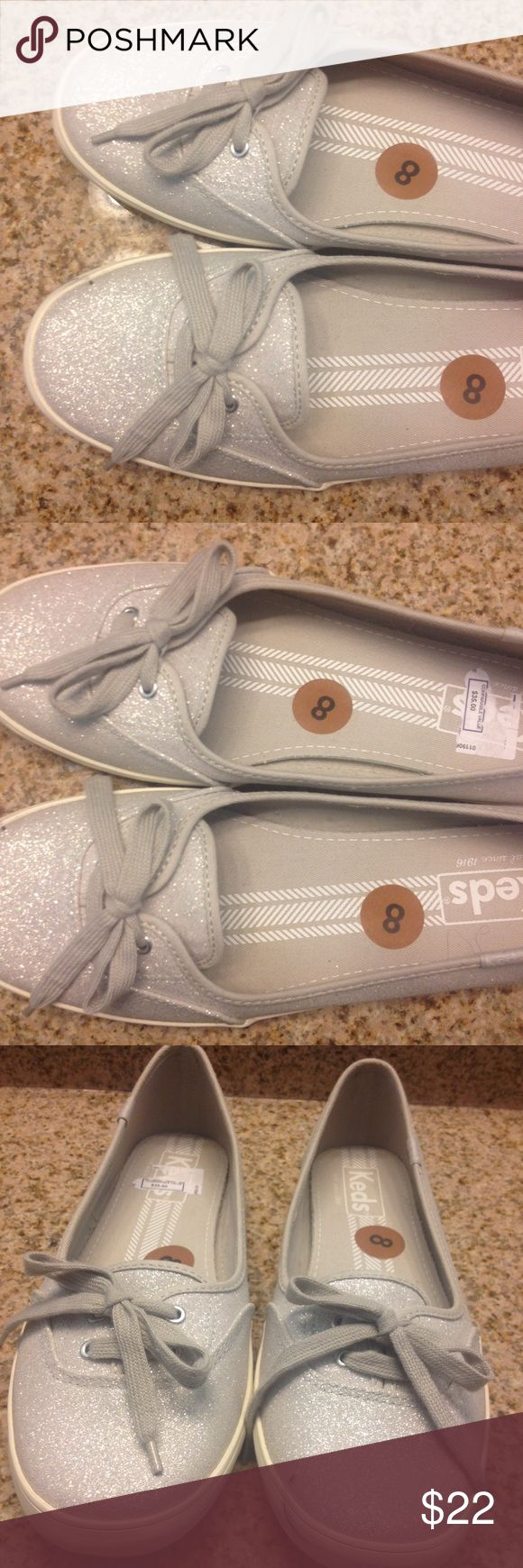 Keds flats Silver flat shoes, like new, worn once. Without box. It has a little dark mark on it, visible in the picture. Keds Shoes Flats & Loafers