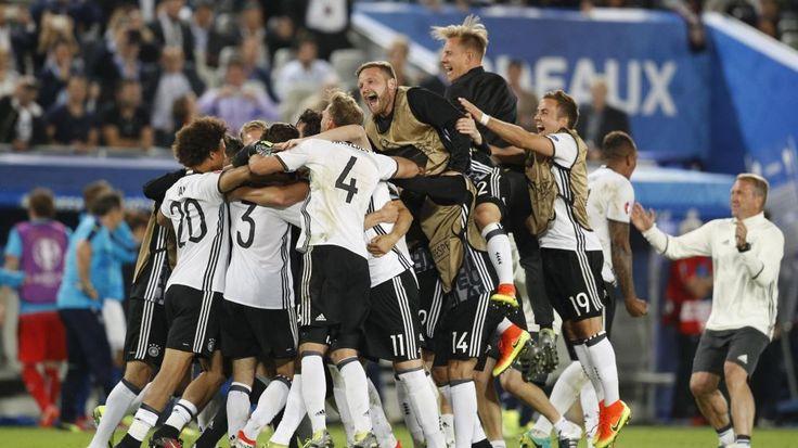 Germany players celebrate winning the penalty shootout