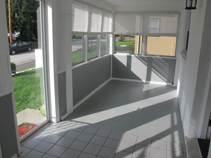Brilliant grey ceramic floors and half sliding glass for Small enclosed patio design ideas
