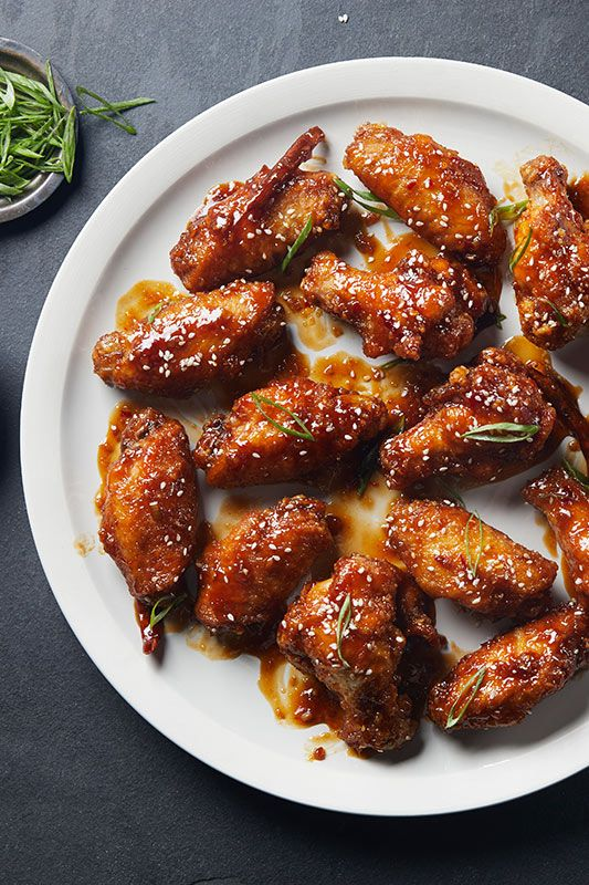 The best part of game day this year is going to be these soy-marinated chicken wings, deep-fried and coated in a spicy General Tso's sauce.
