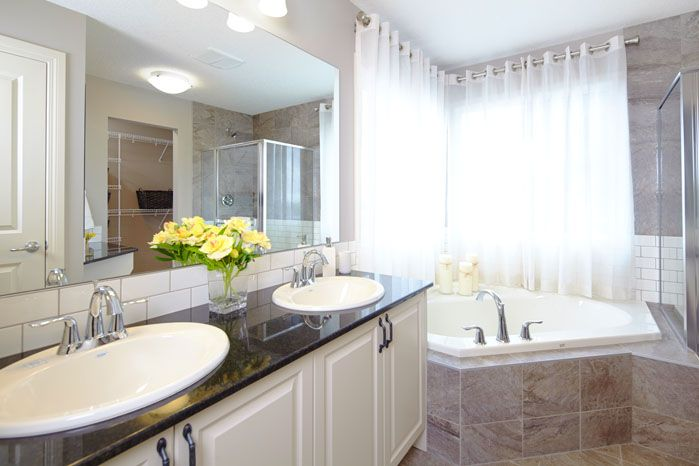 Owner's private ensuite / bath / bathroom in the Orion II showhome in King's Heights in Airdrie by Shane Homes