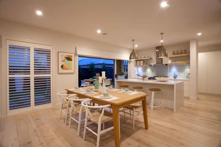 Beach style open plan kitchen and meals area with alfresco.